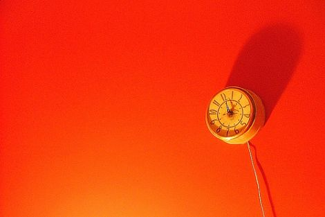 clock on a red wall
