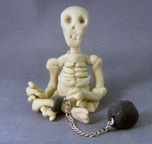 skeleton with ball and chain